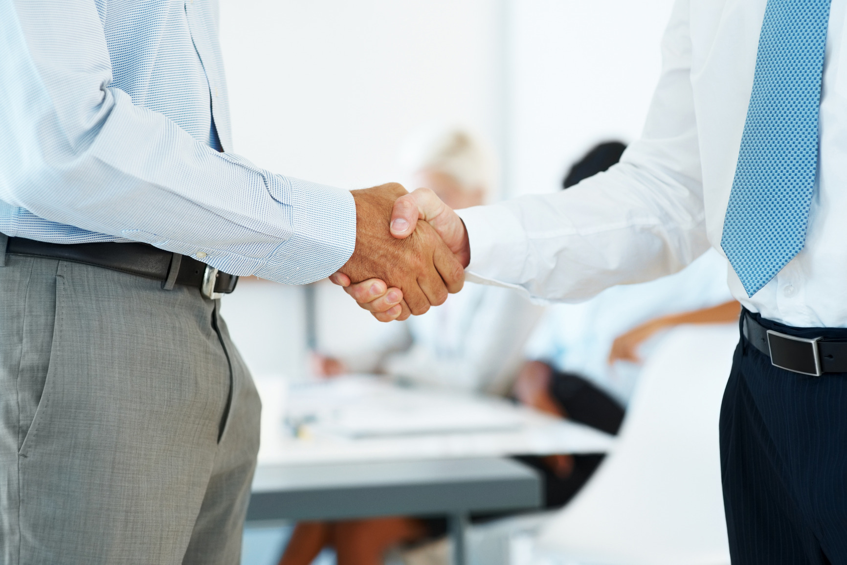 photodune-645934-handshake-of-business-partners-after-striking-deal-m